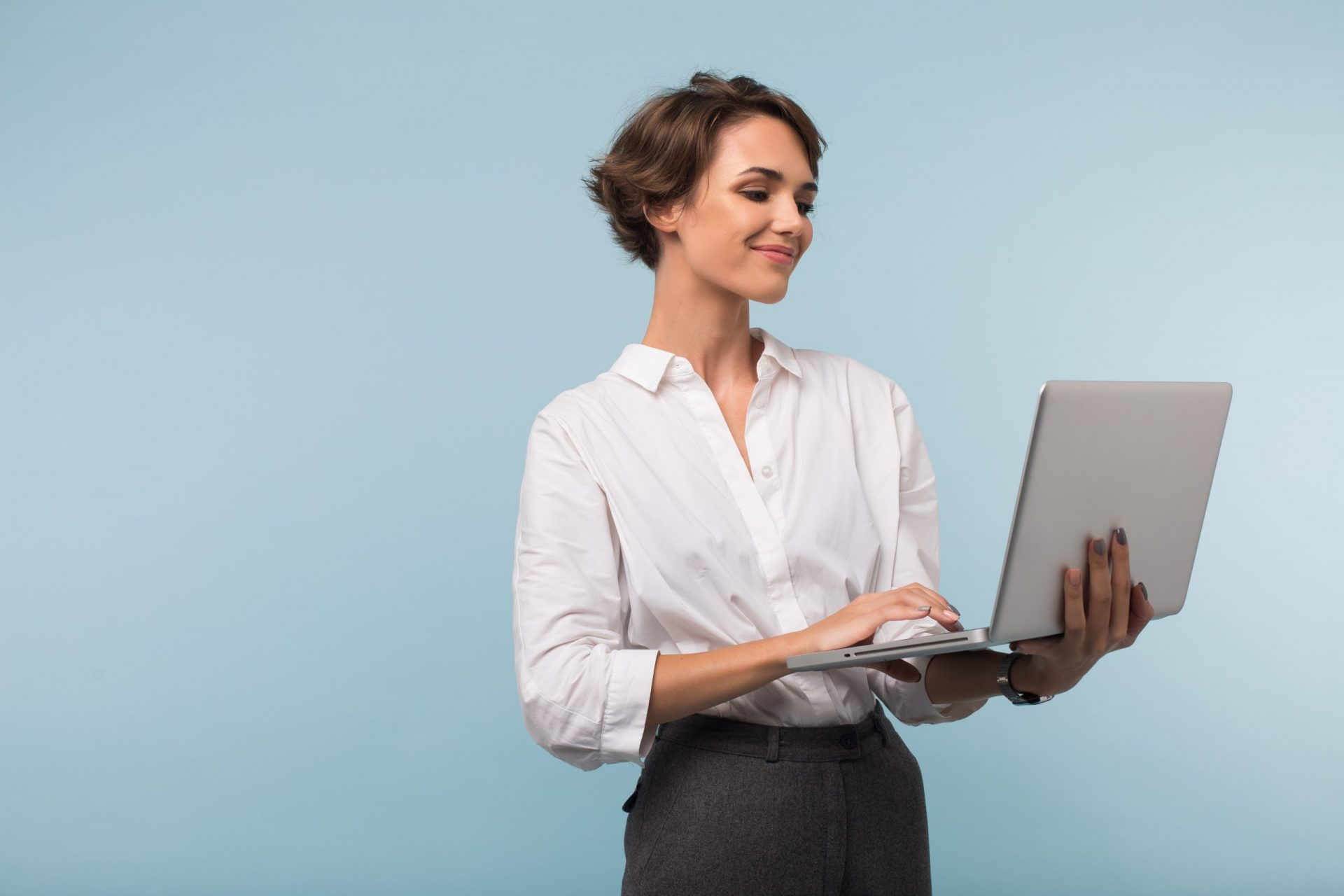 happy subscriber looks at personalized email on her laptop