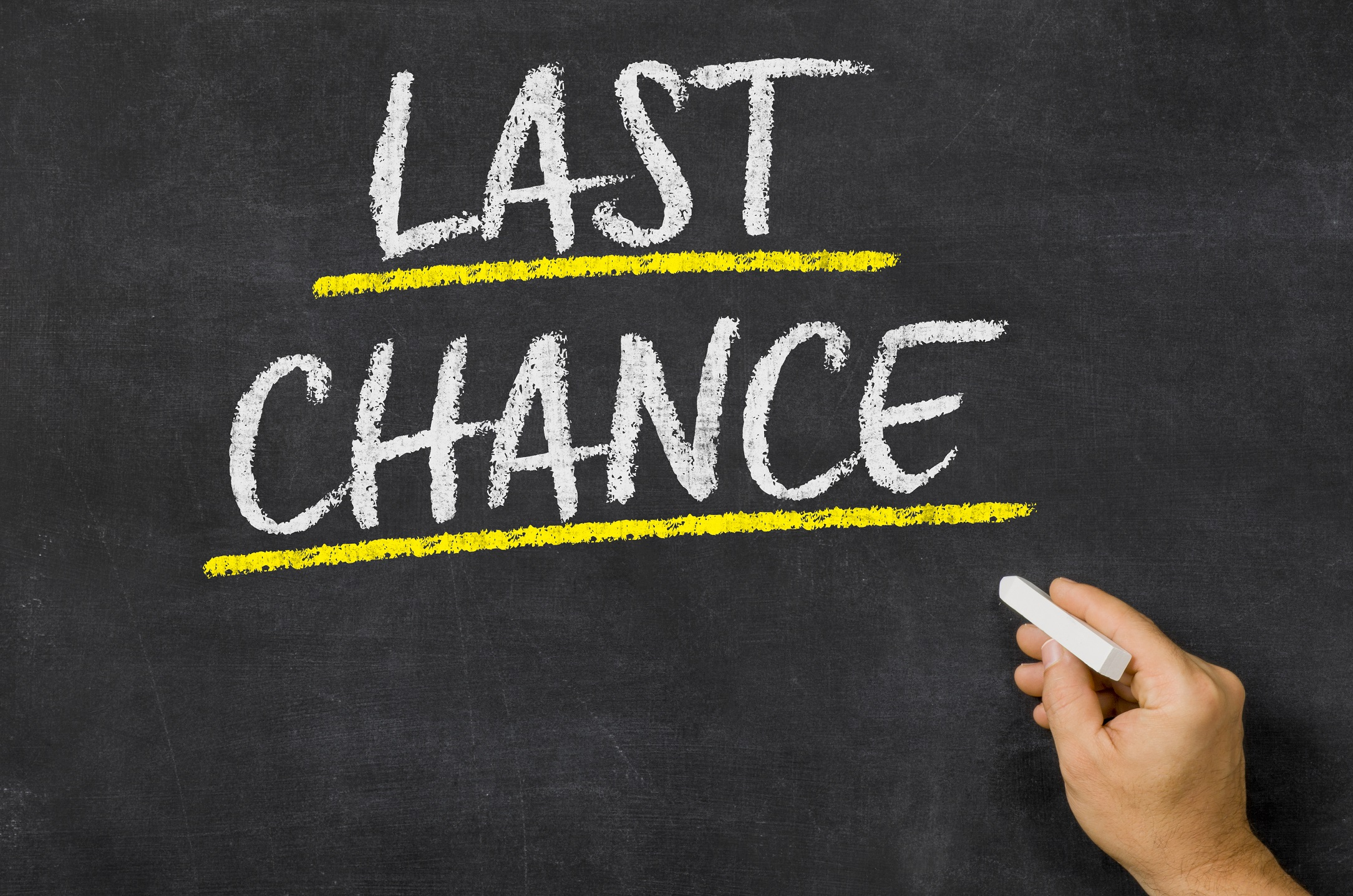 last chance written on chalkboard - signifying using time limits in re-engagement email