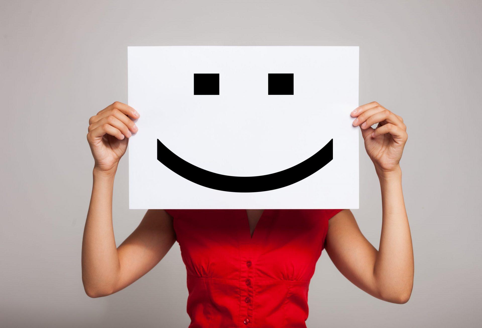 smiley cardboard representing happy affiliate doing email marketing for affiliate marketing