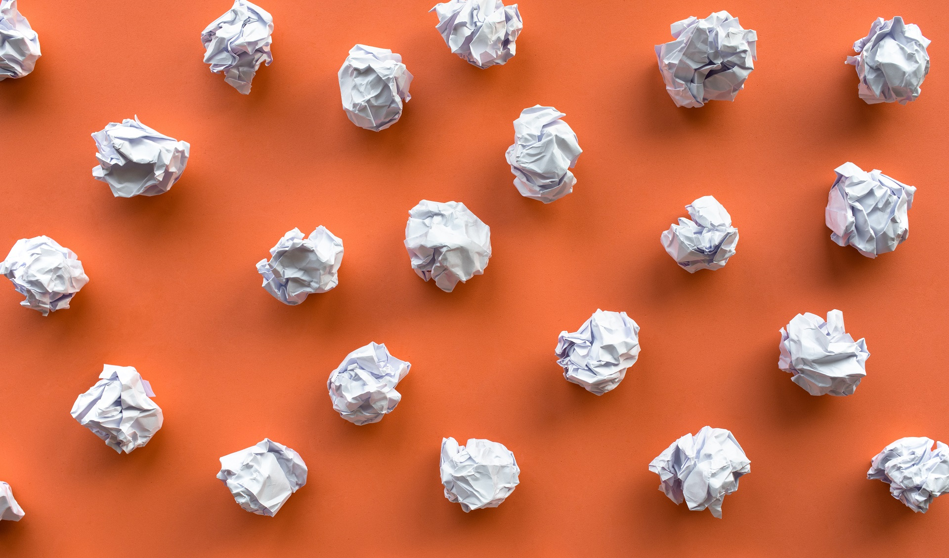 a bunch of crumpled pieces of paper, symbollizing a messy email list