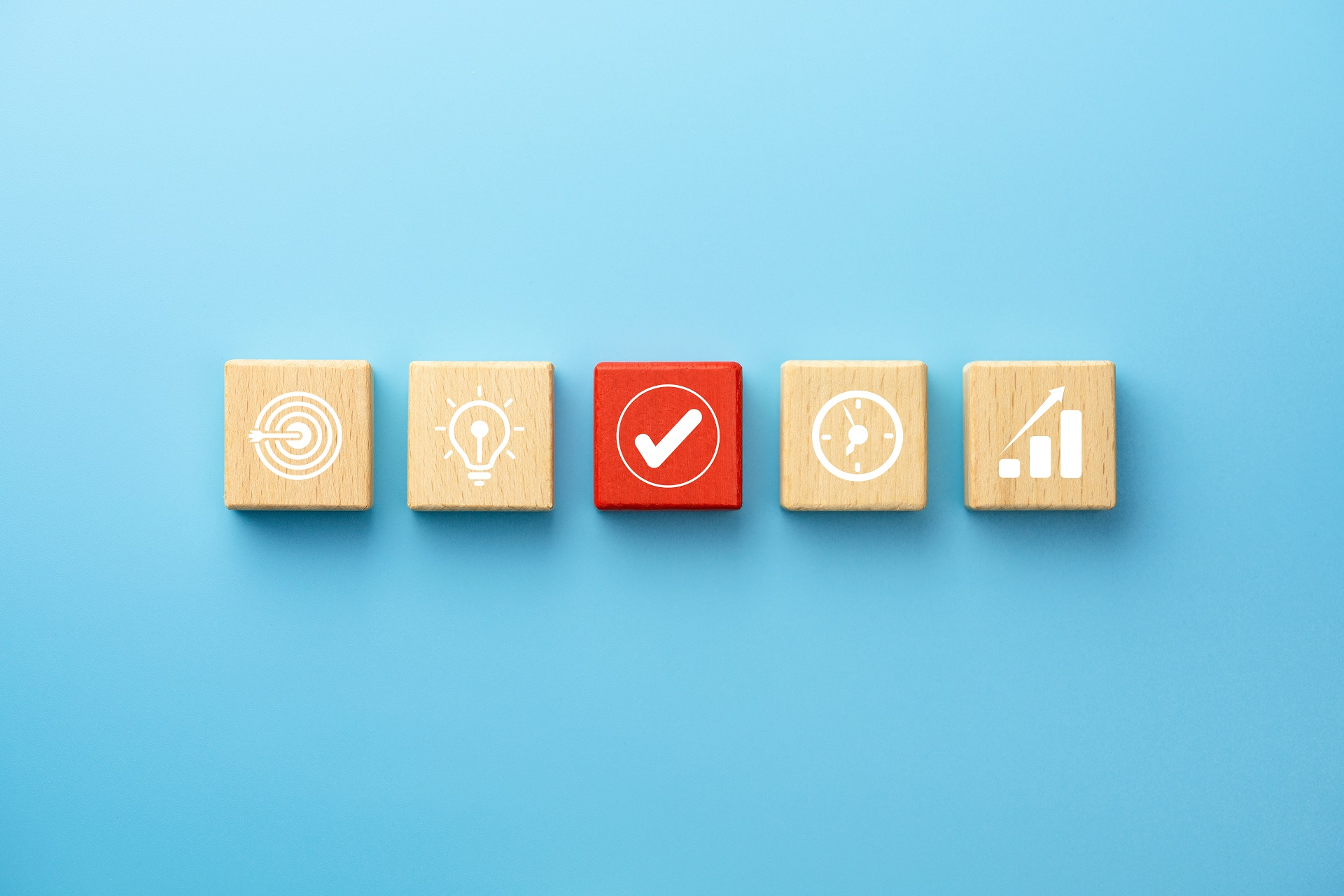Business planing concept with wooden blocks with icon business strategy on blue background